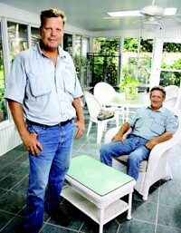 Don Ferguson (standing) with general manager Nick Nicholson. Sunrooms are now on Gold Seal's menu of products.