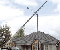 A crane was used to lift the lumber from the street to the deck and set the individual beams on their posts. As the author had no line of sight to the crane operator, the author's wife operated a radio while he guided the lumber into position.