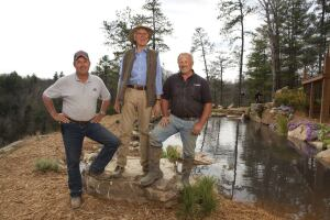 "Backyard wilderness: Anthony Archer-Wills (center) hosts the new Animal Planet series, ""The Pool Master,"" which chronicles the design and construction of natural swimming ponds. Also appearing are excavator Ed Kading (left) and pond designer/contractor Dave Duensing."