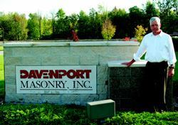Ed Davenport, standing in front of his Holt, Mich., headquarters, is  president and founder of one of the state's highest grossing masonry contracting  businesses.