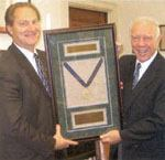 APWA president Bob Freudenthal, deputy general manager of the Hendersonville Utility District, Hendersonville, Tenn., presents Rep. James L. Oberstar, right, with the association's 2005 Distinguished Service Award. Photo: APWA