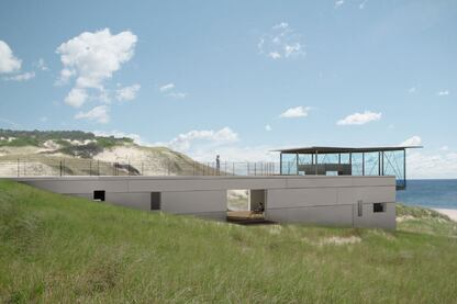 Native dune grasses spread over the roof, helping the building blend with its surroundings.