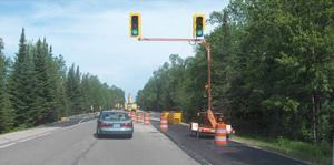 Performance contracting is designed to encourage the use of innovative products like temporary signals that adjust automatically based on traffic volume. Photos: Michigan DOT