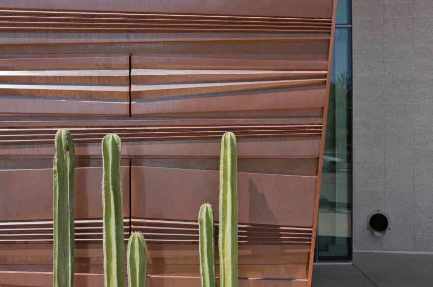 "The horizontal ridges in the copper panels mimic the vertical pleats of the saguaro cactus. The 11-foot-long panels come in 26 different repeating panel designs, each varying in height—12"", 18"", or 30""—and pleat size. The panels are laid in a running bond pattern (to avoid vertical pin stripes)."