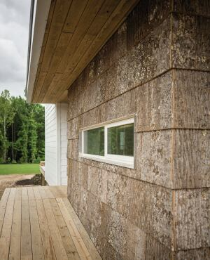 The houses feature NichiProducts fiber board plank siding by Nichiha and poplar bark siding by Highland Craftsmen.