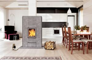 Heat-retaining masonry fireplaces, such as this Tulikivi unit, burn cleanly and efficiently. Many can warm a reasonably sized house.