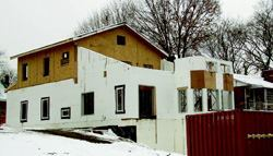 The basement and first floor levels were constructed with ICF concrete  walls while the third floor walls are SIPS panels. Both wall systems have  good insulating properties. Photo: American Polysteel