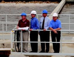 Chuck Hill, Bryan Blake, Glen Whisler, and Kevin Eberle (from left) watch the BNR system in action.