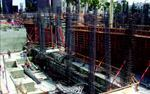 Steel and concrete placement proceed at a furious pace to meet the fast-track schedule.