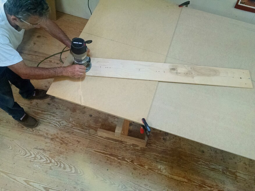 To create a curved form, the author uses a trammel jig for his router to cut MDF at the radius of each rail.