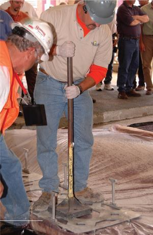 A session at the American Society of Concrete Contractors' annual meeting in San Antonio included a demonstration of stamping pervious concrete through a thin plastic sheet.