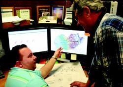 With geospatial time series management, El Dorado (Calif.) Irrigation District information support technician III Timothy Hance, left, and Guy Barritt, GIS/drafting/graphics unit supervisor, could forecast and model trends in drinking water supplies over their entire watershed.