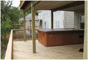 A hot tub weighing 3 tons when full added to the challenge of building an airy deck.