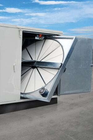 There is an HVAC equipment reduction of 2.5 tons (2.3 metric tons) for each 1,000 cubic feet per minute (CFM) of outdoor air handled by an ERV, such as the rotary heat exchanger pictured above.