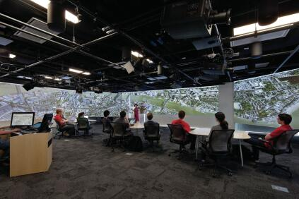 The visualization lab has black box theater lighting grids outfitted with stereoscopic projectors that cast video onto three walls. Adjustable speakers change the sound shape of the room to simulate anything from a concert hall to a forest.