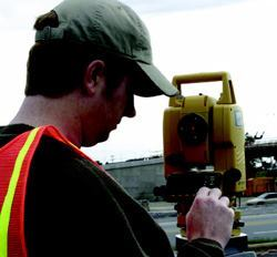 When using a total station (shown here) the points you wish to locate are identified at the instrument. When you use a robotic total instrument, point locations are identified on a screen mounted on the rod.