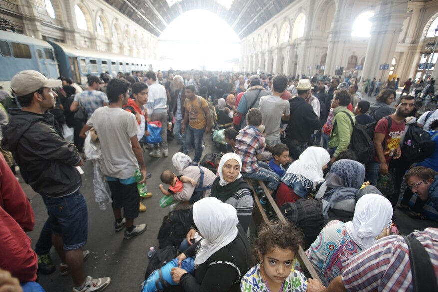 Migrants  wait inside the Keleti Railway Station in Budapest, Hungary. Migrants are now allowed to enter the station but direct trains from Budapest to Western Europe are currently out of operation until further notice.