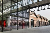Milan Gucci Office Moves to Renovated Aircraft Factory