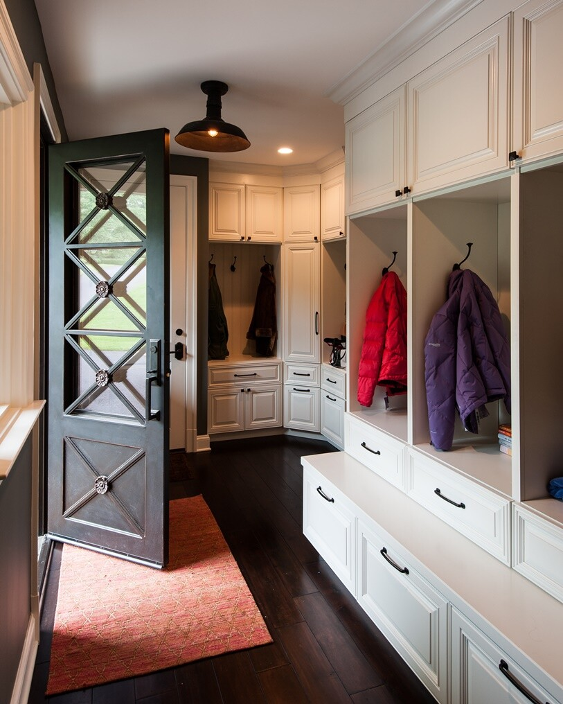 Another popular feature is the multifunctional 'family foyer' as seen here by Bowers Design-Build, a step up from the standard mudroom