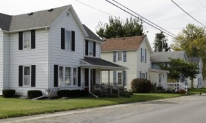 In this photo taken Oct. 11, 2014, a typical looking residential street in Kenton, Ohio. Long seen as having devastated Sun Belt cities, the subprime mortgage crisis has wielded greater economic damage to rural communities, leading federal regulators to pledge continued attention to small-town borrowers as high-cost loans show signs of a comeback. In Rushylvania, a town just south of Hardin County, Ohio, McKirahan, 52, expressed frustration at his never-ending troubles with a subprime loan. Hardin County, and some of its surrounding areas, ranked among the nation's highest in subprime lending; more than 40 percent of loans in Hardin were subprime.  (AP Photo/Jay LaPrete)