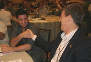 Attendees at Flanagan's session enjoy a game of thumb wrestling and learn where they stand with the game when it comes to the stages of growth.