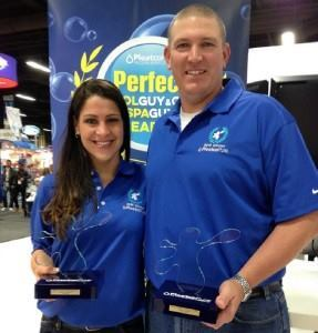 Jamie Gaumond and John Oldfield with their awards after being declared the 2015 Pleatco Perfect Pool Gal and Guy at the PSP Expo.