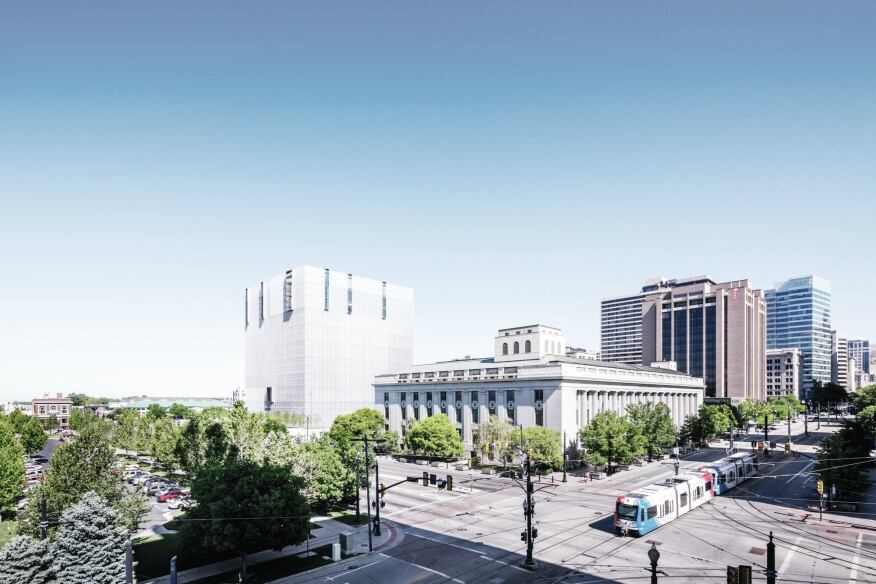 This view from the southeast shows the 1905 Frank E. Moss U.S. Courthouse in front of Phifer's new building. When determining the color for the aluminum louvers that sheath the new structure, the design team looked to the tone of the historic building for inspiration.