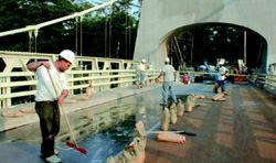 A slurry application will waterproof the bridge deck surface, and can improve skid resistance.