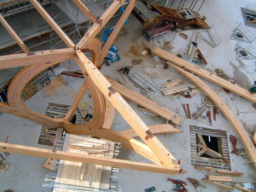 The glulam timbers total more than 25,000 cubic feet of Douglas fir, the equivalent of 60,000 residential studs. Six different jig settings were used to construct the glulam arches.