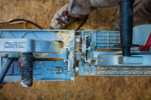 "The baseplate on the Big Foot (left) is ½"" larger than the one on the Sawsquatch (right). Standard base plates run 1 ½"" wide off the blade, but the Big Foot runs 2-1/2"" which gives the saw more stability when cutting at the end of a beam (when working on the right hand side)."