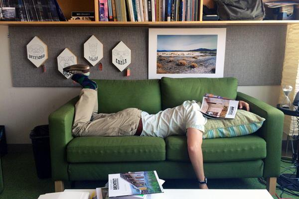 Associate design editor Deane Madsen, Assoc. AIA, tries to get comfortable on one of ARCHITECT's office couches.