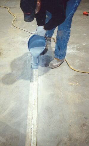 Filling the channel with a mortar composed of low viscosity epoxy and sand.