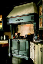 Colored cabinetry can highlight work areas in the kitchen, such as the cooktop  and island (foreground).