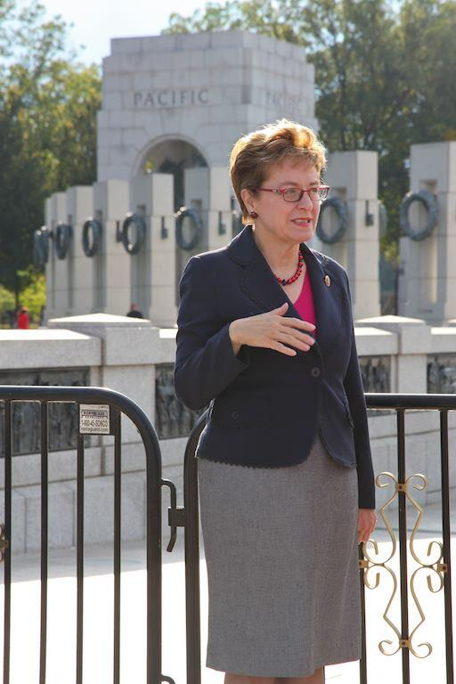 Rep. Marcy Kaptur (D-Ohio) standing in front of the barricades cordoning off the World War II memorial.