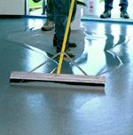A quick way to apply micro-topping material for a large-scale job is to use an asphalt squeegee.