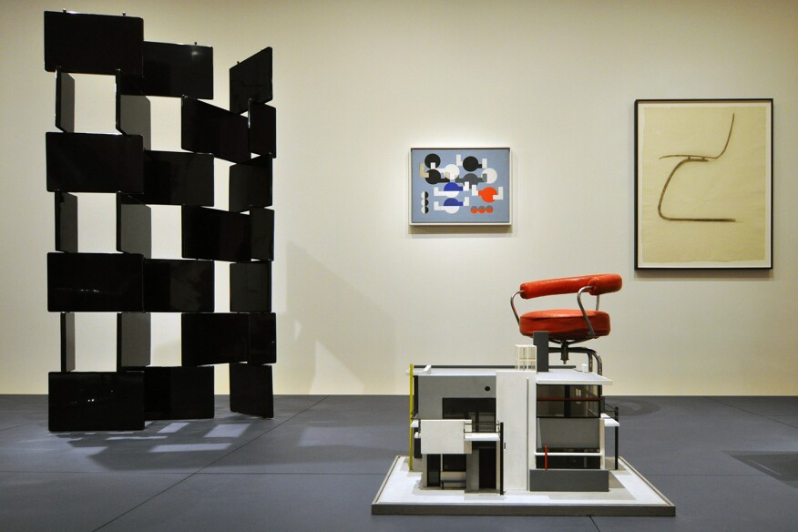 "MoMA's ""Designing Modern Women 1890-1990"" was exhibited in the Architecture and Design Galleries in 2014. Left to right: Screen, by Eileen Gray; Schröder House model, by Gerrit Rietveld with Mrs. Truus Schröder-Schräder; Composition of Circles and Overlapping Angles, by Sophie Taeuber-Arp; Revolving Armchair, 1928, by Charlotte Perriand; Side Chair, by Alvar and Aino Aalto."