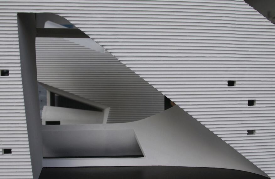 A close-up of the model shows contrasts in materiality and texture between interior and exterior surfaces.