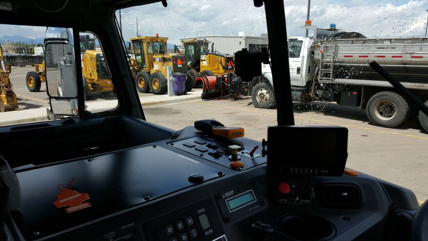 """The """"little black box"""" mounted to this refuse truck's windshield captures video only when something unusual, like a hard swerve, sudden brake, or collision, happens. The video clips are uploaded to the DriveCam Risk Analysis Center, where they undergo human review and are transferred to the City of Denver Public Works Solid Waste Management Division with data that supervisors use to coach drivers."""