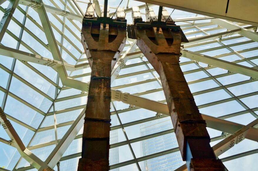 A pair of signature trident columns from the Twin Towers instills a solemn welcome to September 11 Museum visitors.