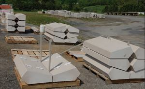 Assorted coping, stair treads, and panels are staged at Sun Precast's yard.