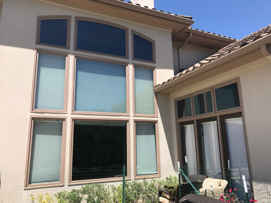 In this before photo, some rot is visible at the brick mold around the windows, but the stucco looks normal, with no signs of rot or failure.