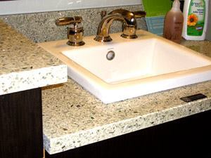 Tile Style: The Vetrazzo vanity countertops in cubist clear offer not only great looks, but also 85% recycled glass countertop.