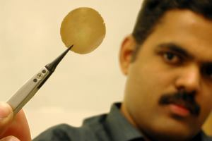 Rahul Nair, who is researching a novel graphene-oxide coating at the University of Manchester, in the U.K., displays a one-micron-thick graphene-oxide membrane.
