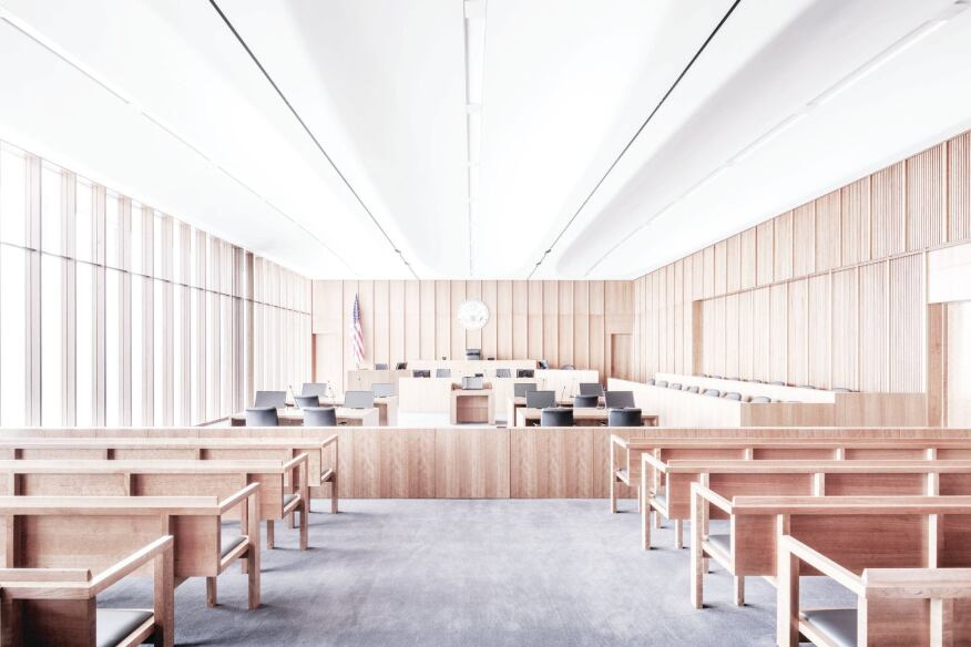 The wood-paneled courtrooms are positioned in the corners of the building.
