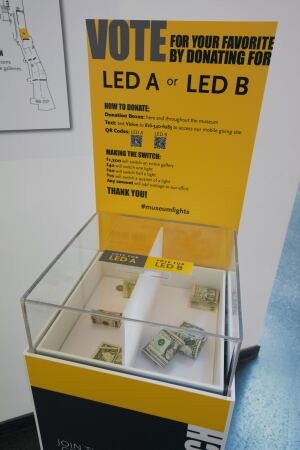 Museum guests can vote for their LED lamp preference by making a donation.
