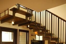 Airy Stair Design of Walnut and Steel