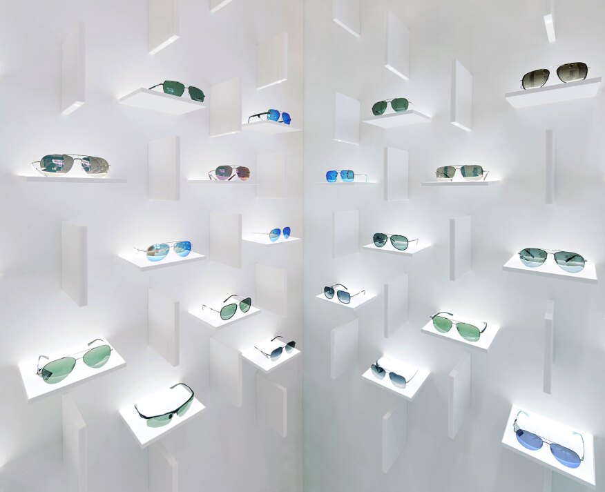 "A system of vertical and horizontal ""fins"" form the sculptural setting to showcase the eyewear."