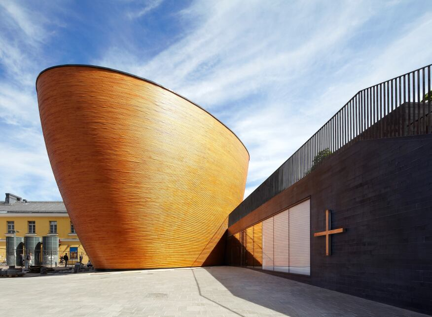 A curved wooden chapel in a northern square architect for Wood architectural columns