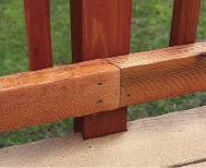 Figure 2. The guardrail posts anchor to the outside of the rim joists, so only one course of decking had to be notched at the rims. Installing the decking from the rim toward the house placed a full-width board above the rim for easy notching and attachment