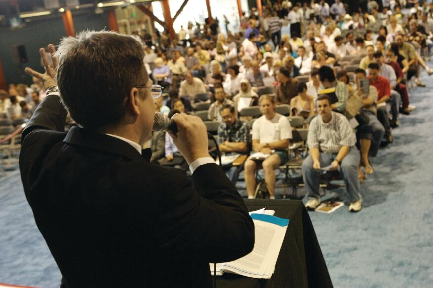 ON THE BLOCK: An auctioneer conducts an event in Los Angeles for REDC, which last year held 232 auctions in ballrooms and online.
